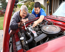 Two men working on a car