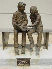 A picture of the sculpture to the left of the library's main entrance, The Art of Reading by Preston Jackson
